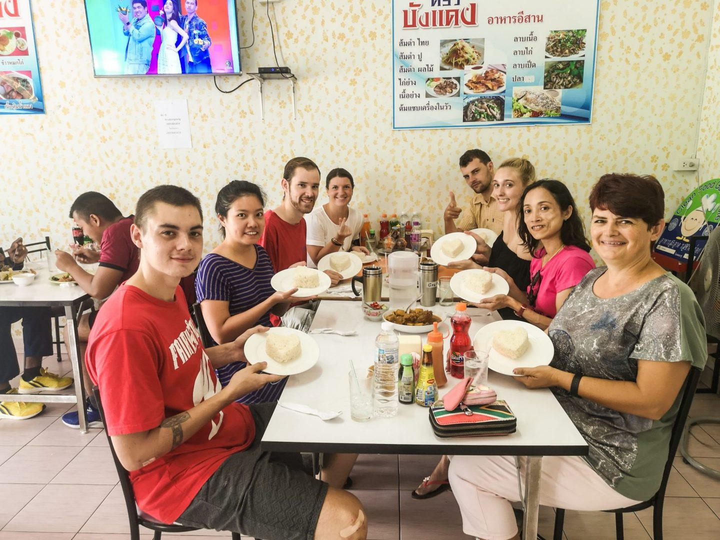 Byron and Tammy with a bunch of friends in Thailand, eating lunch