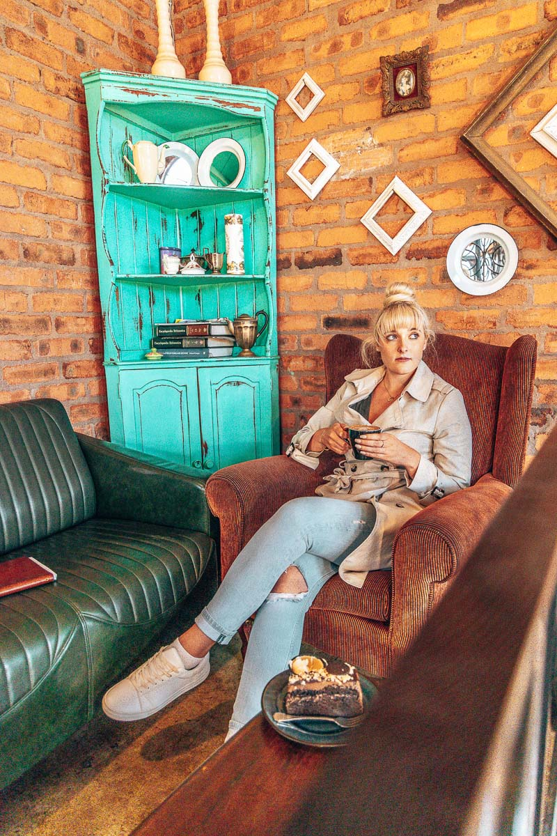 Tammy sitting with coffee at Farmer's Daughter