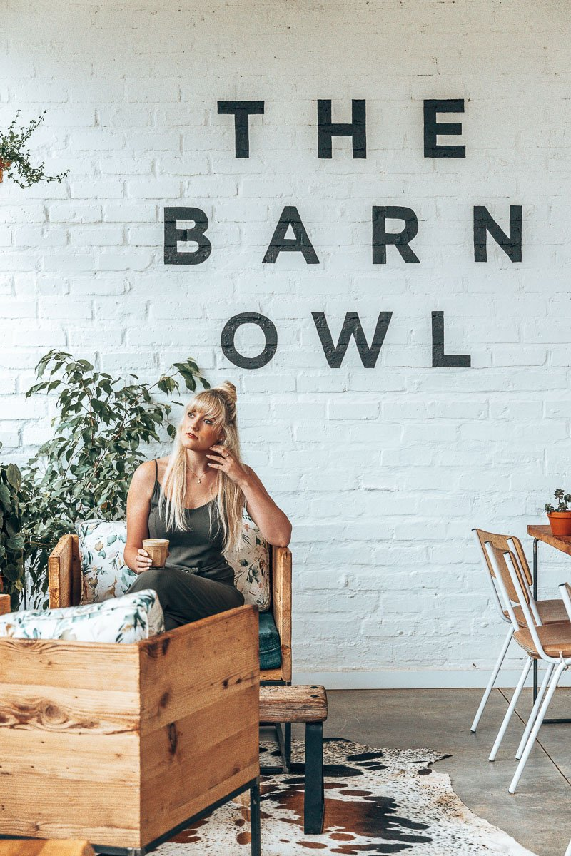 Tammy drinking coffee at the Barn Owl Coffee Shop