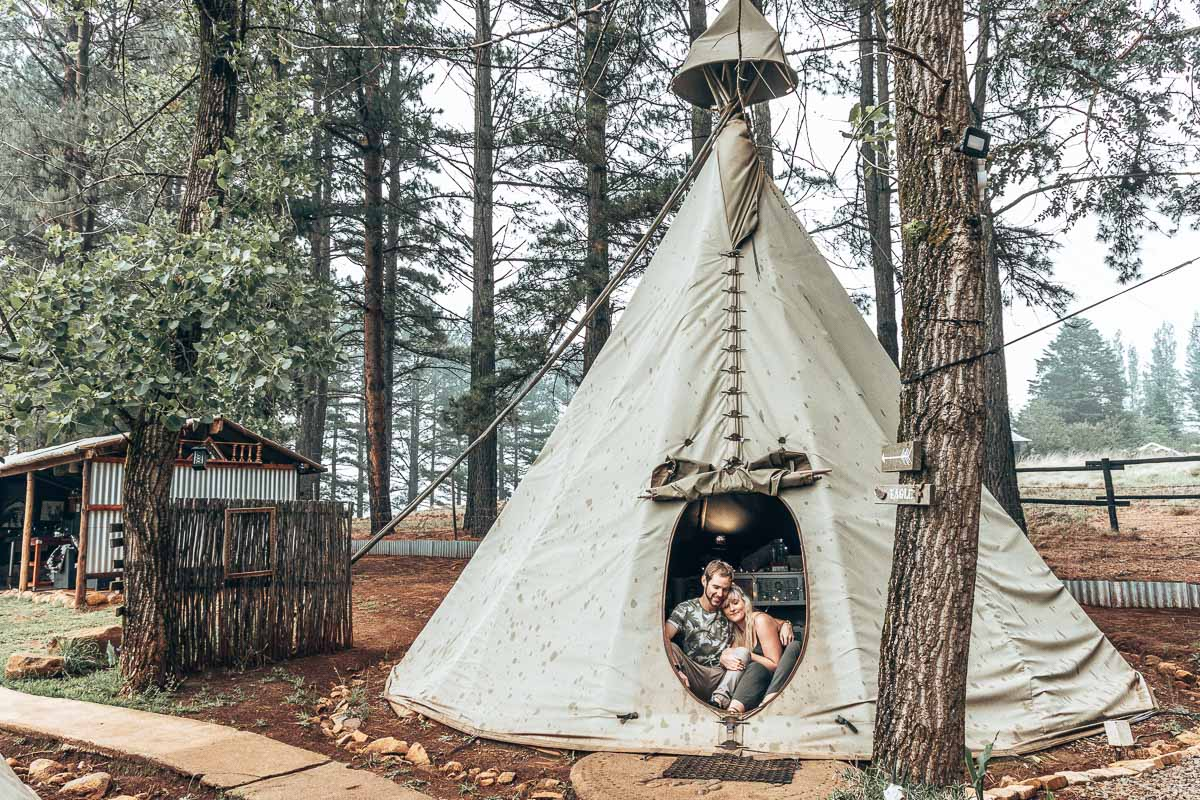 Cuddling up with coffee inside a teepee tent.