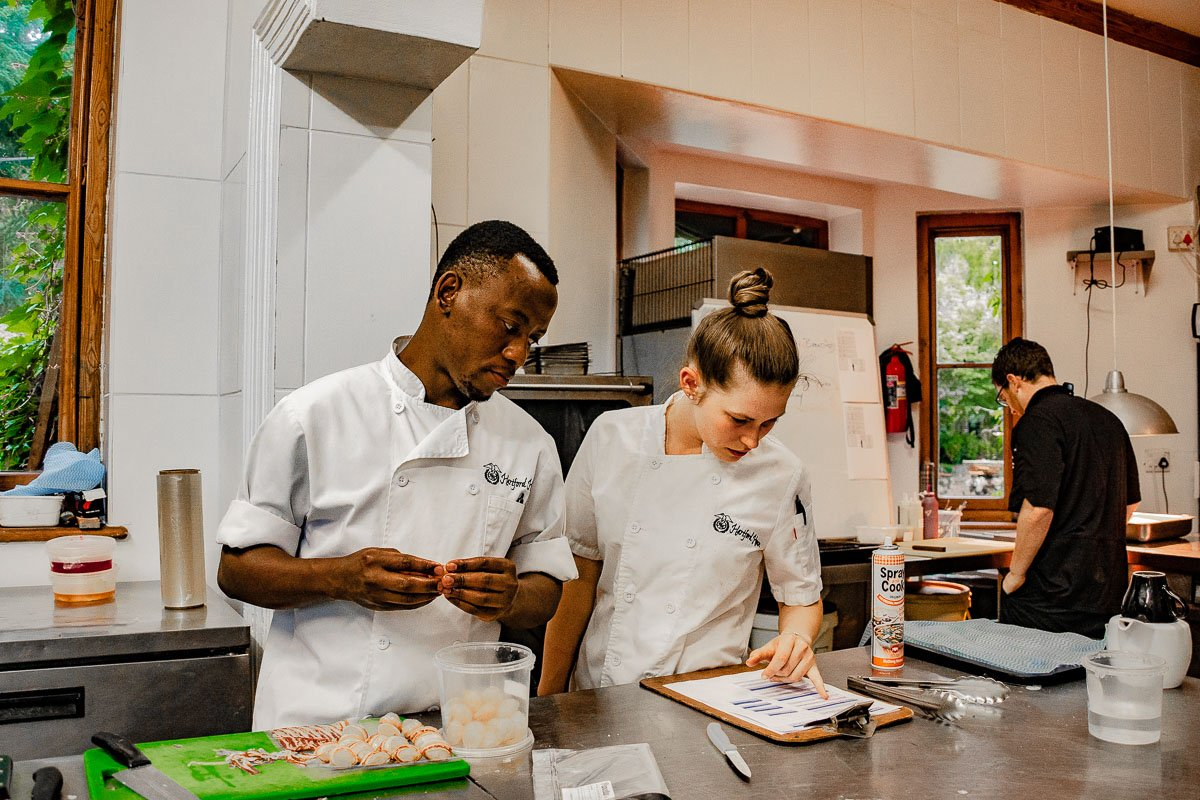 Chefs preparing food at Hartford House