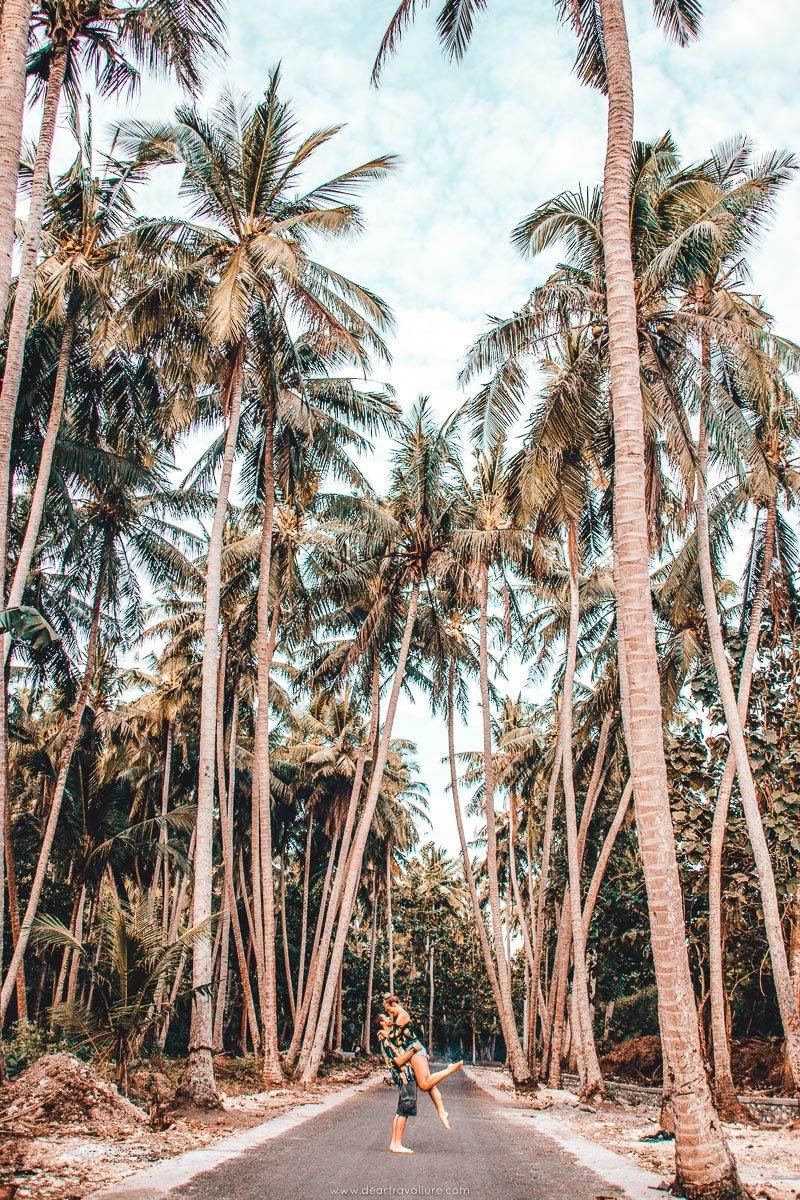 Couple on Palm Tree Road at Crystal Bay Beach Nusa Penida