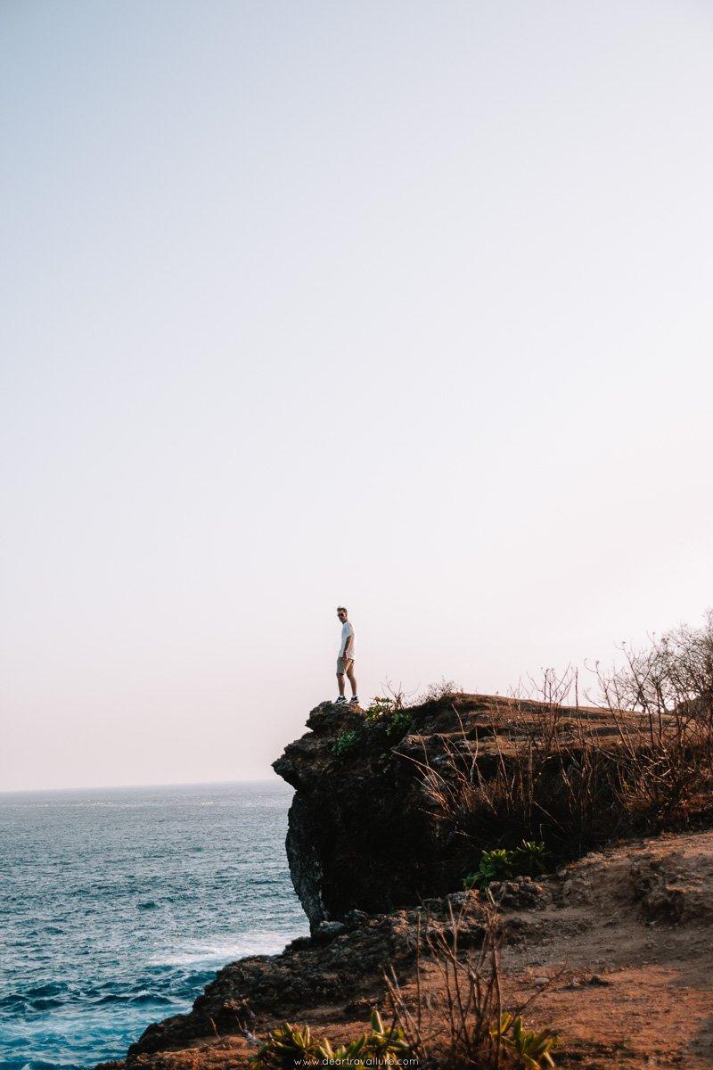 Man standing near the edge of Broken Beach