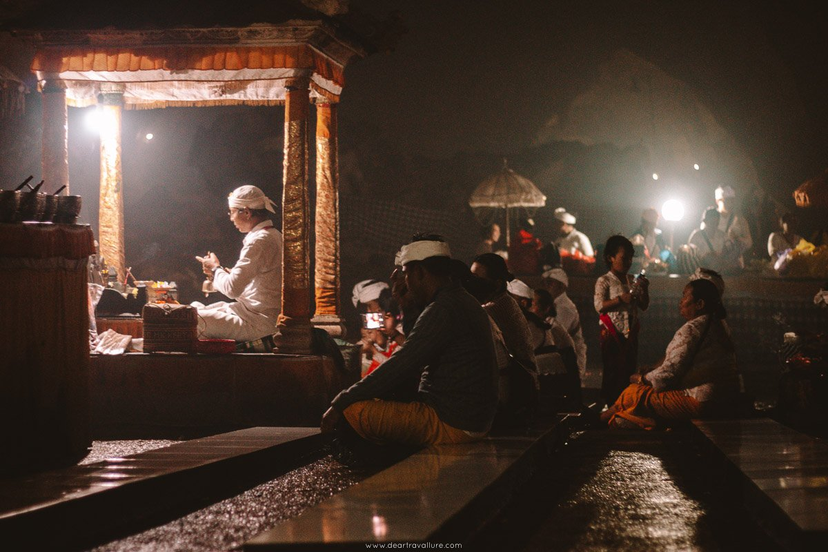 Worshipers at Pura Goa Giri Putri Balinese underground temple