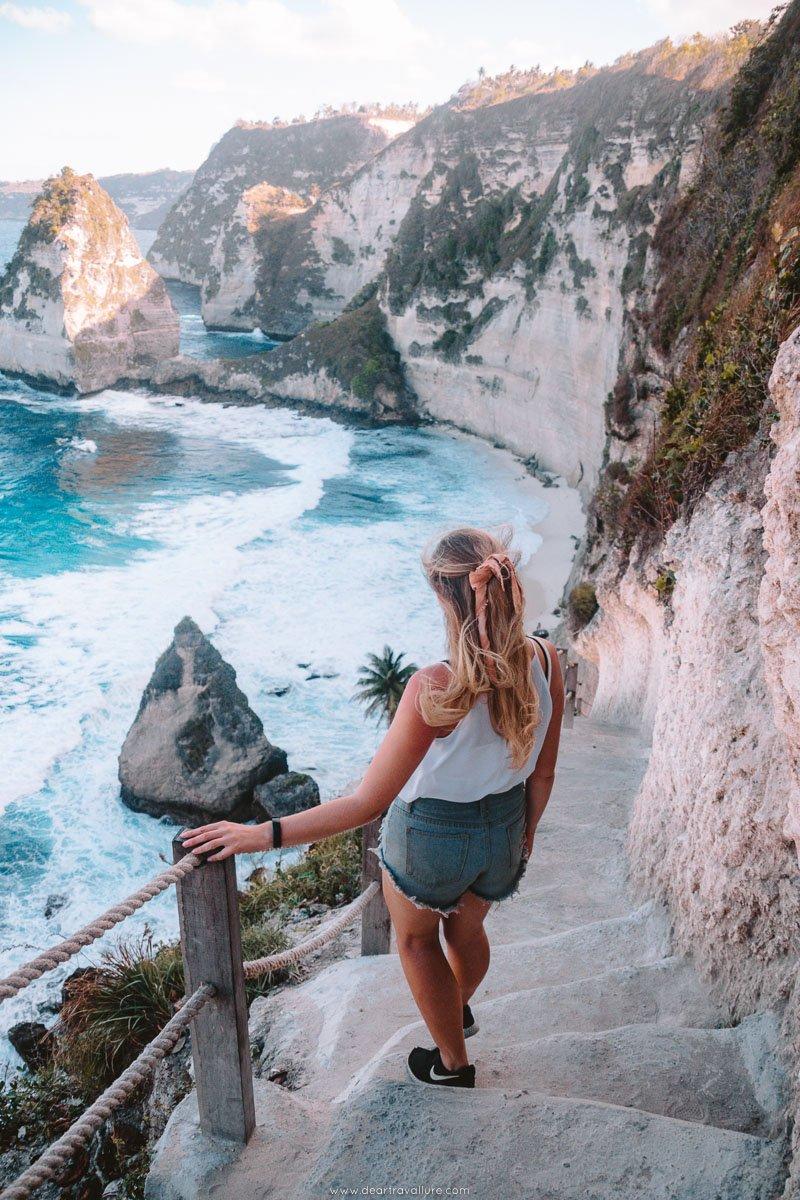 Girl walking down to Diamond Beach