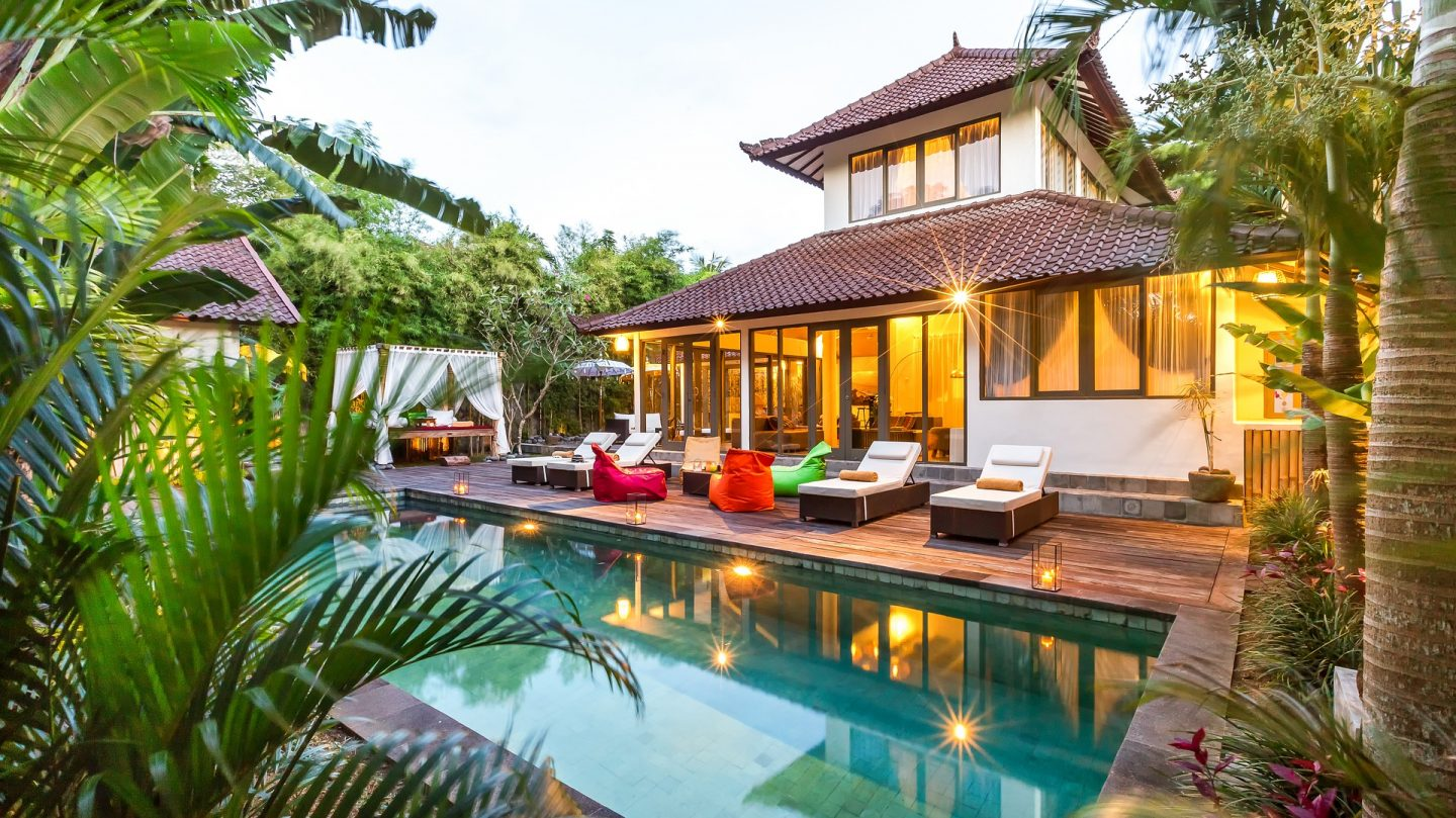 A luxury villa in Bali with a pool, deck and outside seating