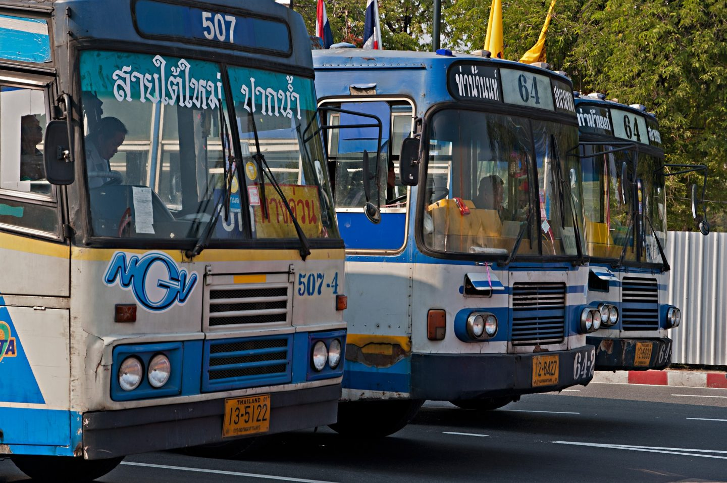 Blue buses lined up in a Bangkok Bus Station