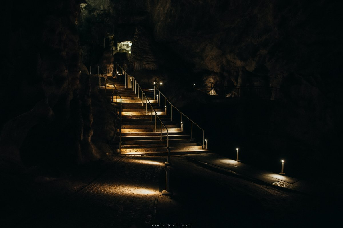 Well-lit stairs leading up a higher cave section