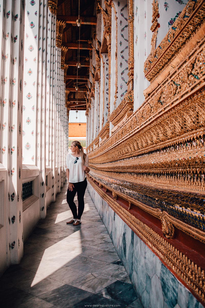 A girl standing in the passageway at Wat Arun