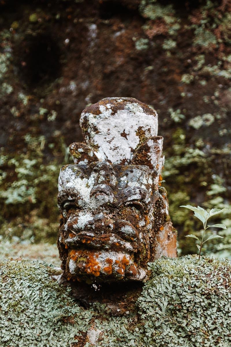 Ancient Statue covered in moss at Pura Gunung Kawi