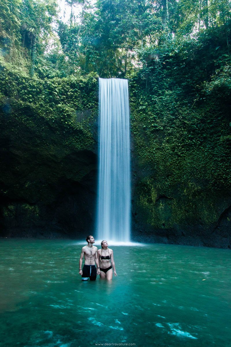 Couple in the water at Tibumana Waterfall