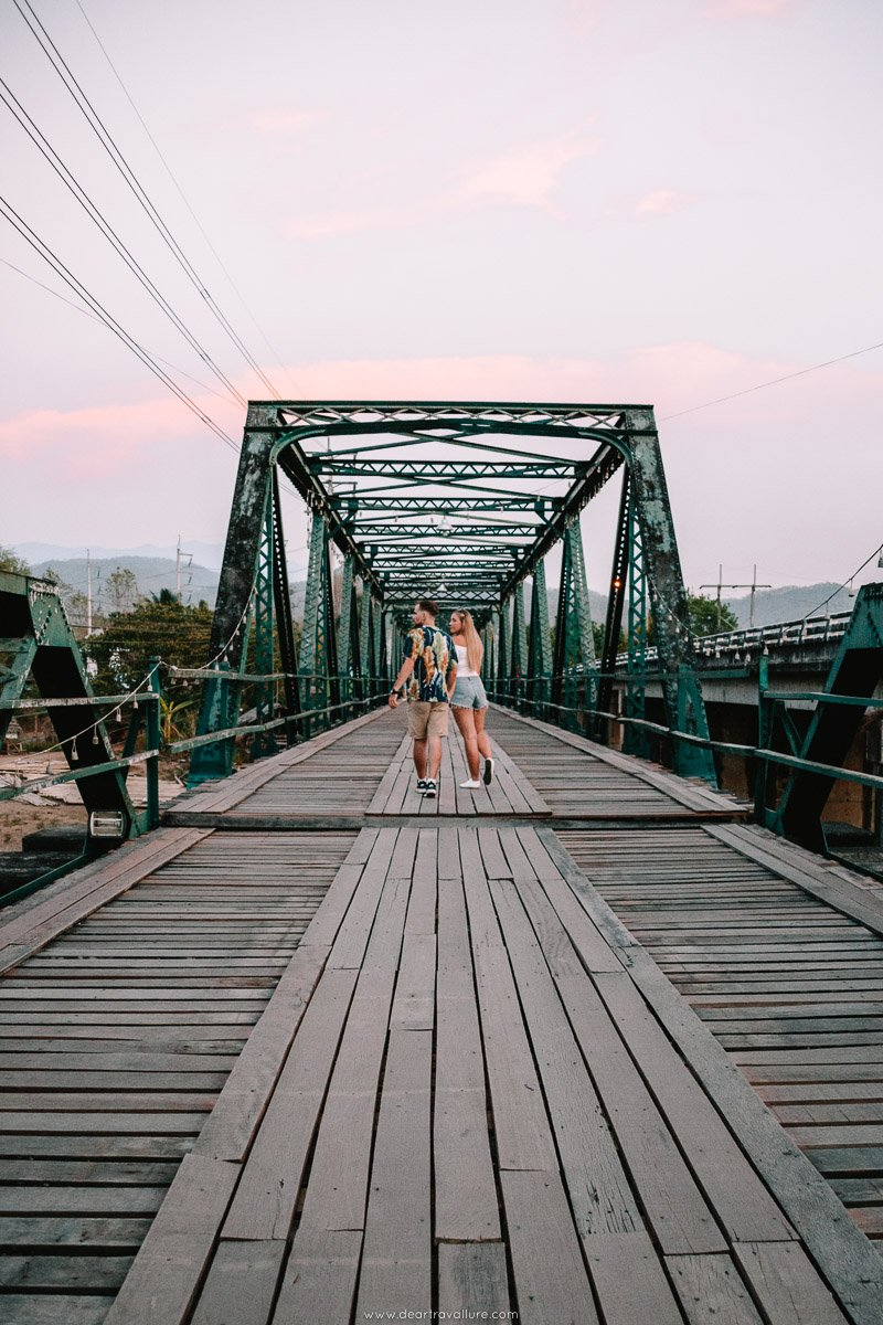 Couple Crossing the Memorial Bridge in Pai
