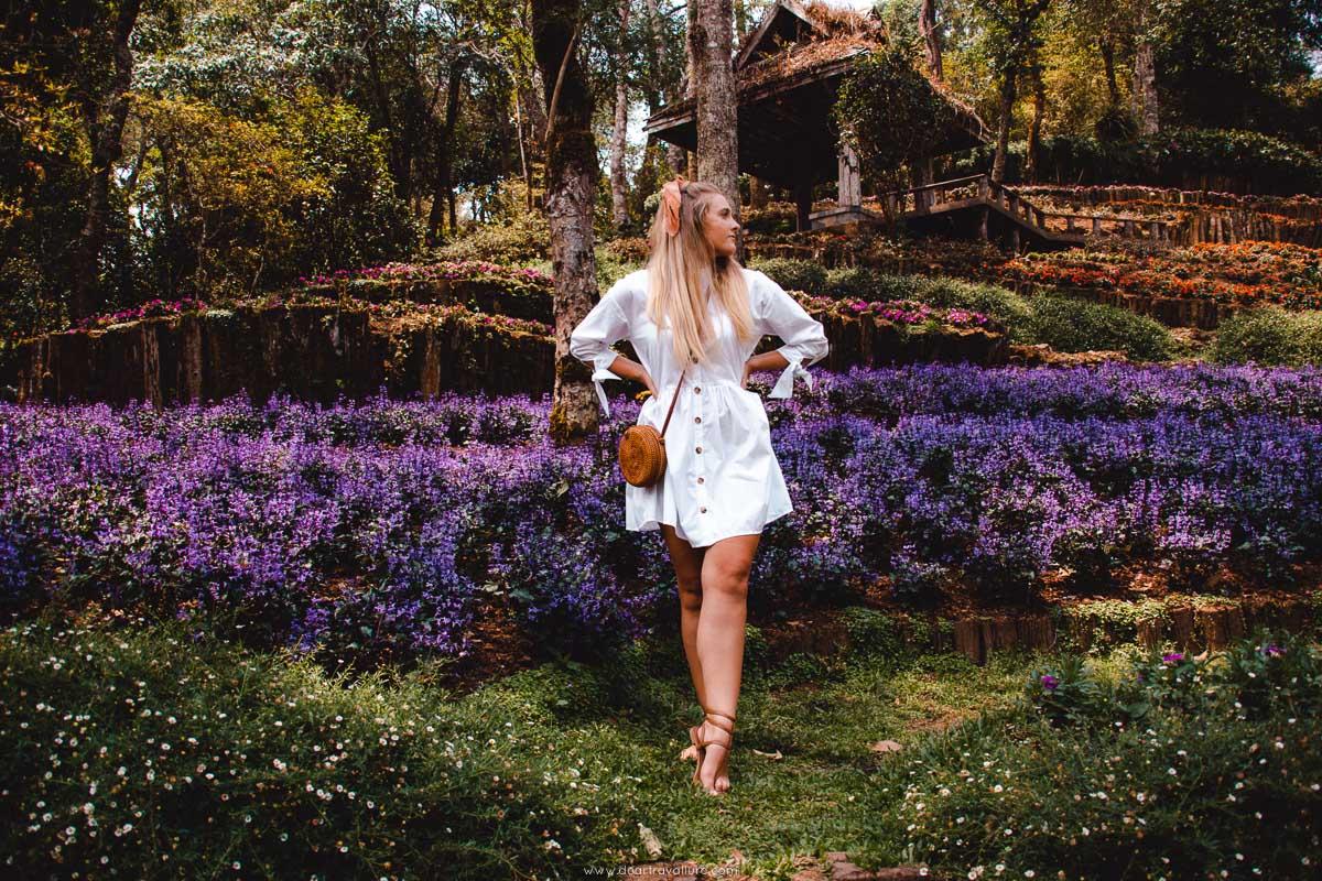 Tammy standing near purple flowers