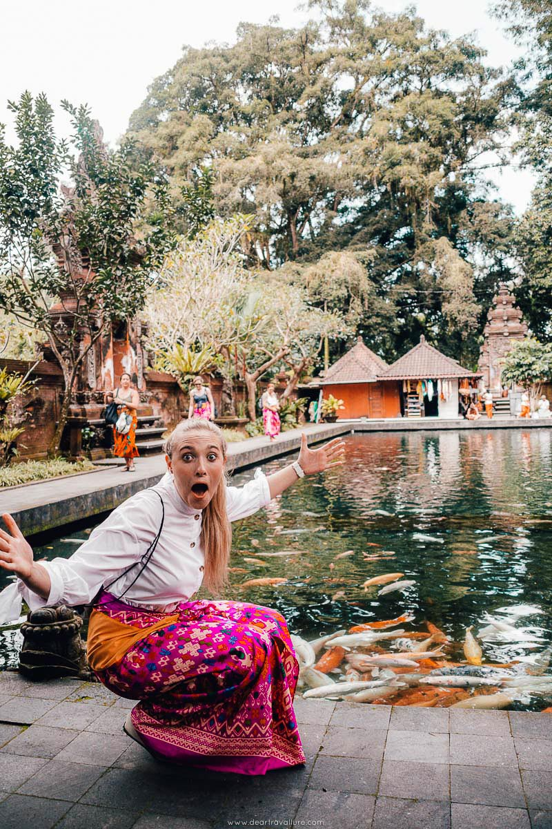 Tammy exaggerating about the size of the fish at Pura Tirta Empul