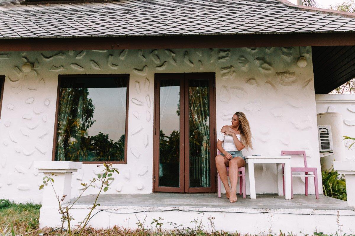 Girl sitting at a villa at Bura Lumpai Resort