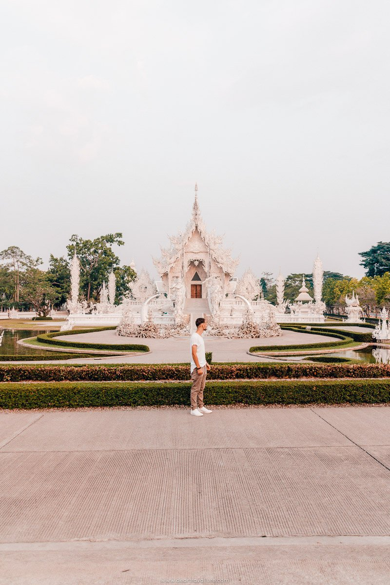 Byron standing in front of the White Temple in Chiang Rai