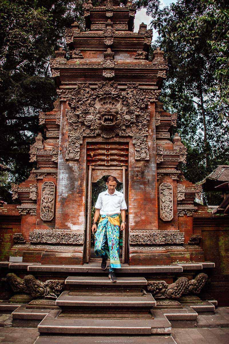 Byron walking through a Balinese Temple doorway at Pura Tirta Empul
