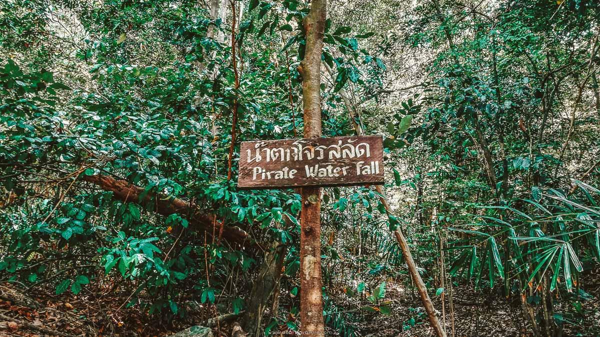 """A wooden sign written """"Pirate Water Fall"""""""