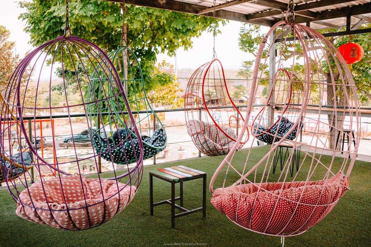 Swinging chairs at the Container in Pai