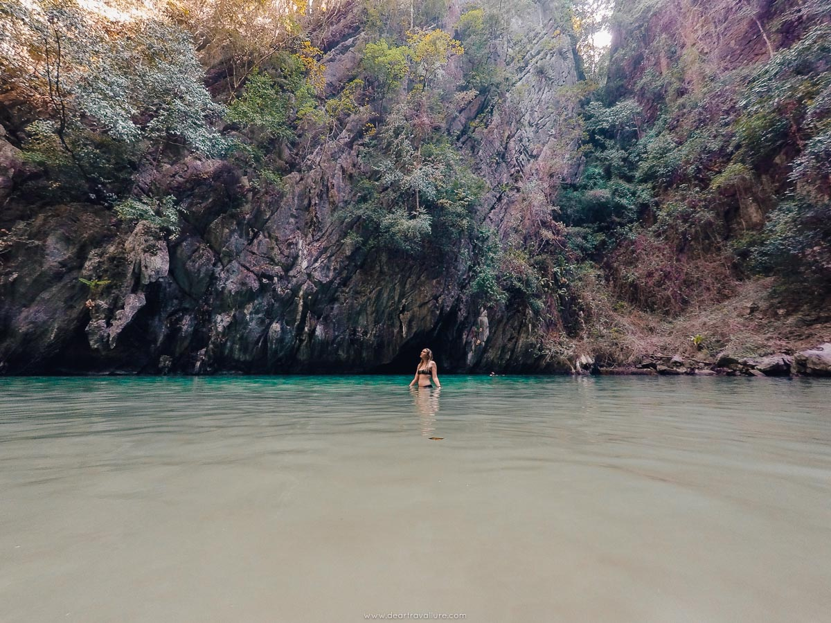 Tammy wading in the water of the Emerald Cave