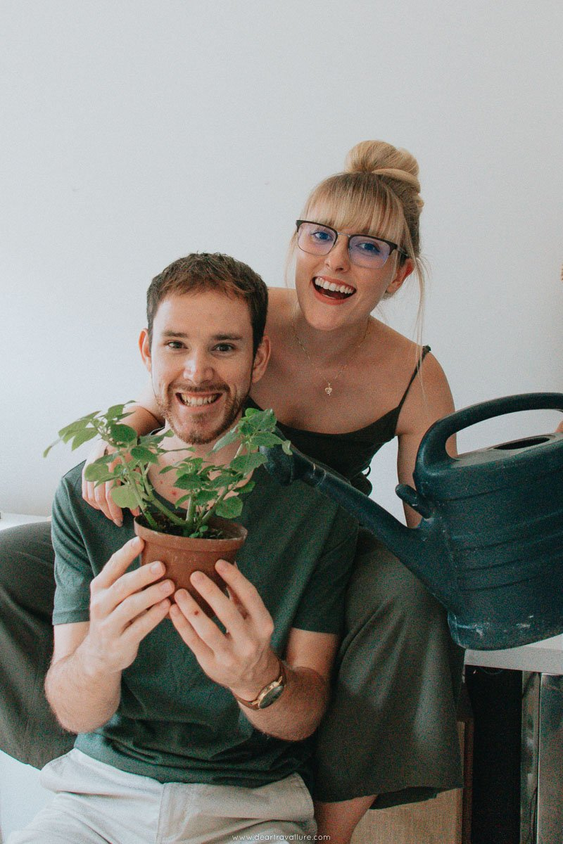Byron and Tammy watering a plant