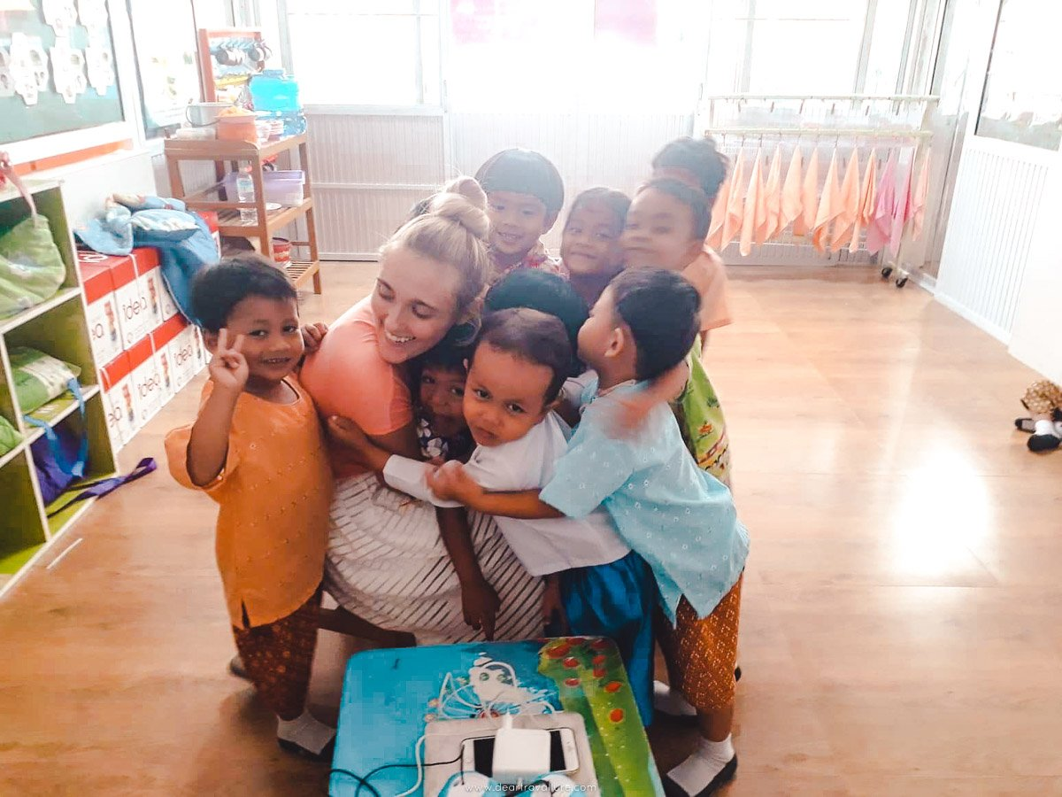 Tammy hugging her entire Kindergarten Class