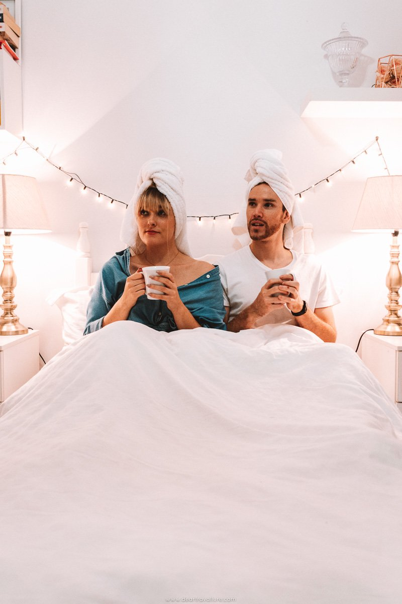 Sitting in bed with towels on our heads, with coffee