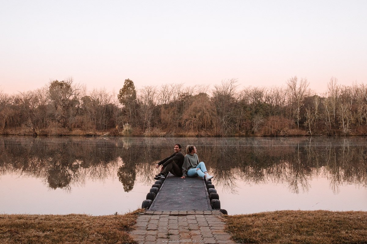 Byron and Tammy sitting on a jetty and taking in the view over the Vaal river