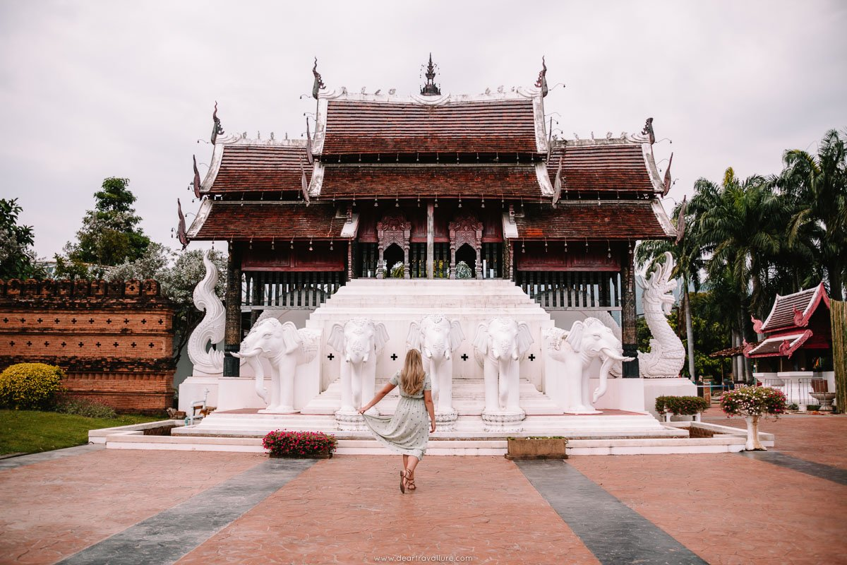 Tammy standing in front of the entrance to Royal Park Rajapruek