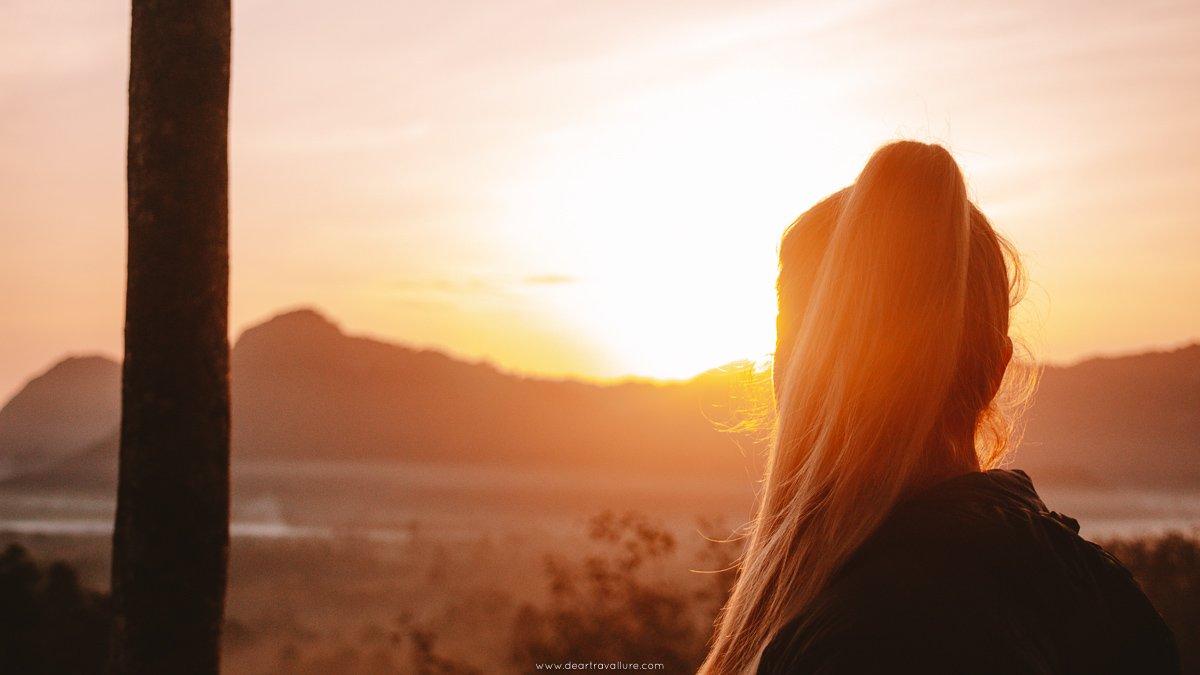 Tammy watching the sunrise from Kuan Dancing Bird Viewpoint