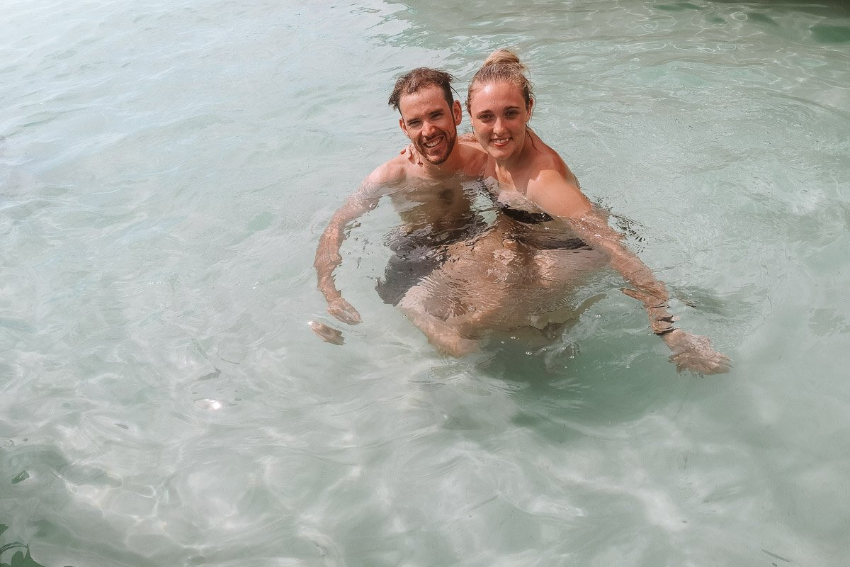 Byron & Tammy swimming in crystal clear water.