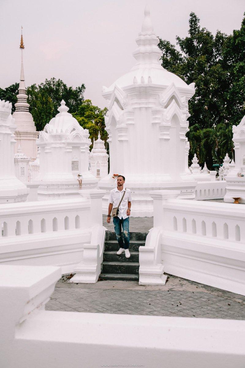 Byron walking amongst the white chedis at Wat Suan Dok