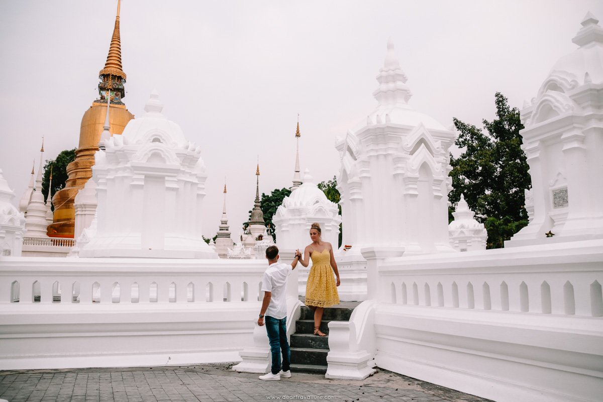 Byron and Tammy amidst the white Chedis at Wat Suan Dok