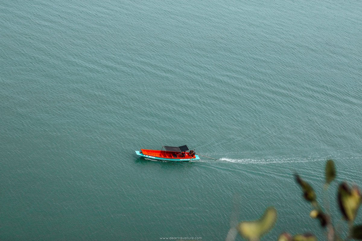 Long tail boat speeding along the water