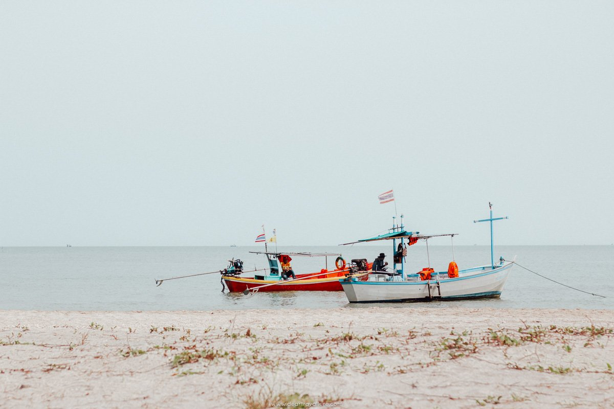 Long tail boats parked at the beach