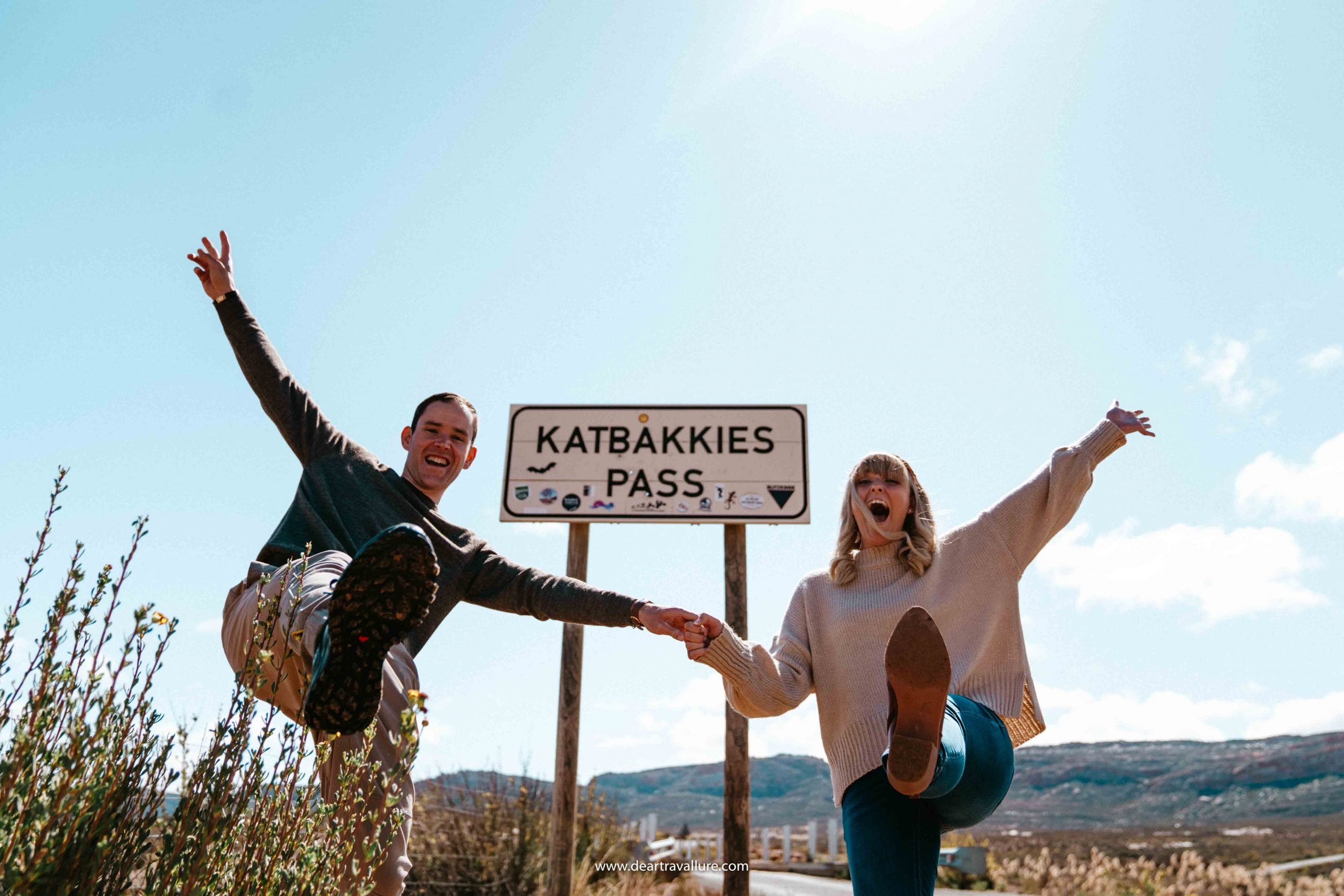 Byron and Tammy with outstretched arms by the Katbakkies Sign