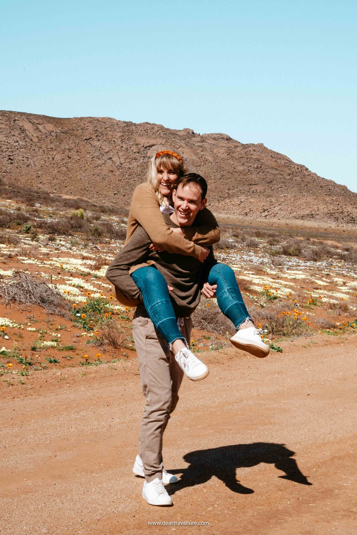 Byron giving Tammy a Piggyback Ride through the Namaqualand Flowers