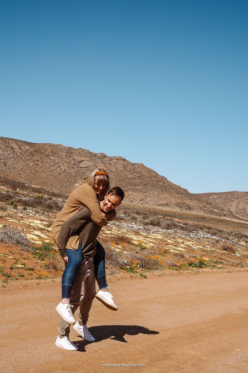 Byron giving Tammy a piggyback ride through the reserve