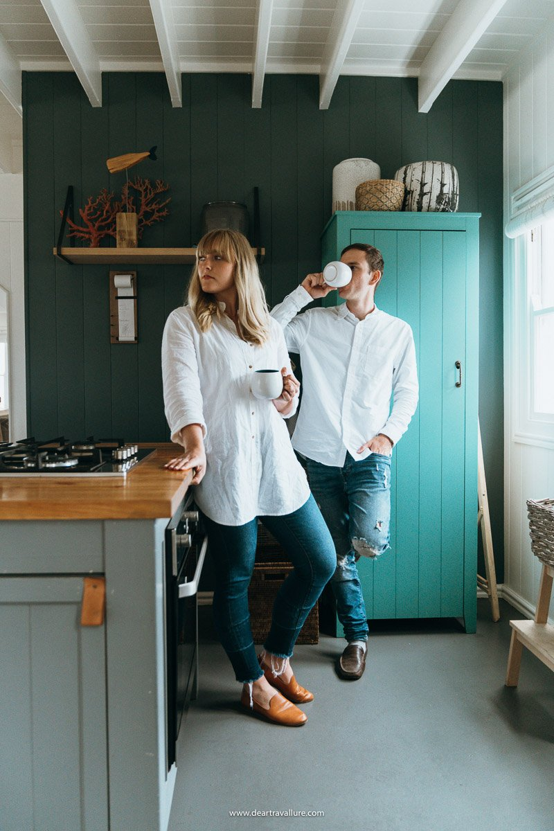 Byron and Tammy sipping coffee in the dream worthy blue kitchen